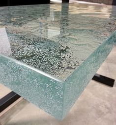"This 2"" ultra clear glass countertop is cast with our new Geode texture! It has just finished being polished and is getting ready to ship out from our studio in Waterloo, IA."
