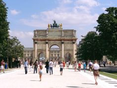 The Louvre museum and former palace can be seen through the arches of the Arc de Triomphe du Carrousel as well as part of the sign that is on the Louvre pyramid, showing just how many tourists and locals walks the path throughout a day.  See more www.eutouring.com
