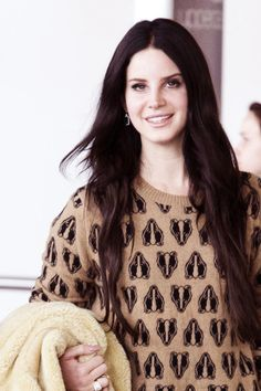 Lana Del Rey. I absolutely love the fact that she is wearing a honey badger sweter❤