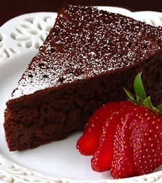 Preheat oven 375°F and butter cake vorm. Line bottom with paper and butter paper. Melt chocolate with butter. Add 3/4 cup of sugar and 3 eggs and whisk well. Add 1/2 cup cocoa powder. Bake in middle of oven 25 minutes, or until top has formed a thin crust. Cake keeps in airtight container, 1 week.