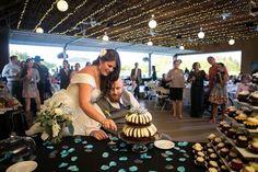bride and groom cut their fruitcake | http://www.mywedding.com/articles/ali-and-cybils-elegant-sonoma-ca-wedding-by-viera-photographics/