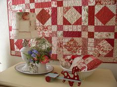 Love the red and white quilt!