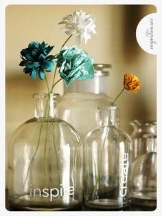 apothecary jars and paper flowers