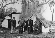 Hessian and bark shelters at Stanthorpe, 1872 - Four men pose in front of bush dwellings at Stanthorpe. The dwellings are constructed of hessian walls and rough bark slabs. Old Pictures, Old Photos, Malayan Emergency, Colonial Cottage, Early Settler, Australian Bush, Victorian Photos, Hessian, Historical Pictures