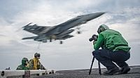 170523-N-YA681-174   PACIFIC OCEAN (May 23, 2017) Mass Communication Specialist 2nd Class Sean Castellano, from Colorado Springs, Colo.,  records video footage on the flight deck of the Nimitz-class aircraft carrier USS Carl Vinson (CVN 70) in the western Pacific region. The U.S. Navy has patrolled the Indo-Asia-Pacific routinely for more than 70 years promoting regional peace and security. (U.S. Navy photo by Mass Communication Specialist 2nd Class Rebecca Sunderland/Released)