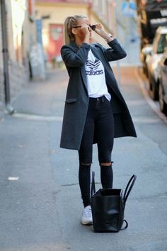 Gray coat over white tee and trendy distressed black jeans.