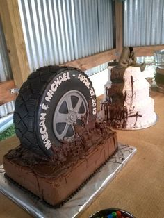 This is a set of cakes I did for wedding yesterday.... Very country outdoor wedding.... Thankfully the rain held off so it wasnt truly a muddy wedding.  The tire is made of RKTs.