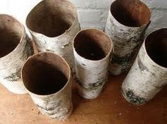 Birch bark tubes perfect over glass cylinder for wedding reception centerpieces available at birchsupplies.com