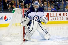 COLUMBUS, OH - APRIL 6: Eric Comrie #1 of the Winnipeg Jets prepares for the second period while making his NHL debut during the game against the Columbus Blue Jackets on April 6, 2017 at Nationwide Arena in Columbus, Ohio. (Photo by Kirk Irwin/Getty Images)