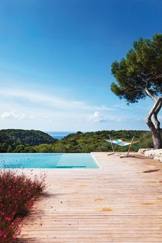 View from the pool at Villa Cala Binigaus in Menorca, Balearic Islands, Spain. Photo by: Mirjam Bleeker