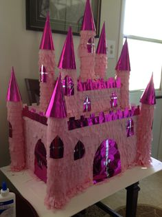 Castle princess pinata, made for my daughter birthday,expended about $10.00 , used two boxes, two swimming noddles from dollar tree, 3 rolls of crepe paper also from dollar tree, and a roll of foiled raping paper, oh an a pack of birthday hats for the roofs.