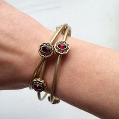 Jessica Simpson Gold & Ruby Bangles Very cute with any outfit! Great condition. Inside across measures 2.5 inches! Jessica Simpson Jewelry Bracelets