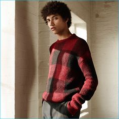 Jackson Hale shines in a black and red buffalo check sweater with grey trousers from Zara Man.