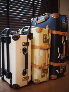 3 Globe-Trotter Suitcases