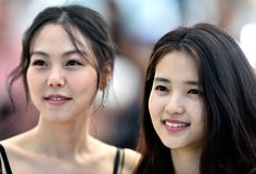 """Actresses Kim Min-Hee and Kim Tae-Ri attend """"The Handmaiden (Mademoiselle)"""" photocall during the 69th annual Cannes Film Festival at the Palais des Festivals on May 14, 2016 in Cannes, France."""