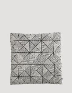 The textile of the TILE cushions are especially developed with the skilled designers and crafts people of the Norwegian textile mill Gudbrandsdalens Uldvarefabrik, who have been weaving premium quality wool textiles in the factory since 1884. The pattern of the TILE cushion gives the impression of a three dimensional structure, which makes it an interesting and eye catching piece in any living room or lounge area.