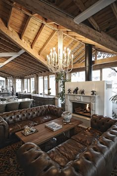 I really like the double chesterfields and the long rustic table between them.