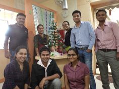 Few of our team members with #Xmas Tree...