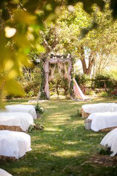 Outdoor, rustic wedding ceremony {So Eventful wedding & events}