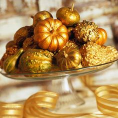 Golden Gourds:  Spray-paint a mix of small gourds shimmery gold, and stack them on a glass cake plate to create an elegant display.