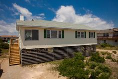NEW OWNERS IN 2010 UPGRADED THIS CHARMING CLASSIC BEACH COTTAGE: RENOVATED BATHROOM, LIVING ROOM FURNITURE, DECKS, AND CENTRAL HEAT & AIR! Swell Times will steal your heart with it's beachy furnishing...