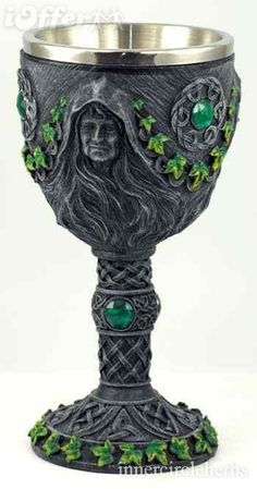 sacred chalice, this wonderful  ritual tool has been carefully sculpted with interwoven, Celtic designs  and accented with green jewels and painted, green foliage,
