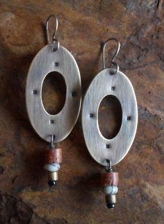 Brass Tribal Shield Earrings, African Bauxite Earrings, Earthy Primitive Rustic Dangle Ethnic Earrings, Black & White Stone Earrings. $50,00, via Etsy.