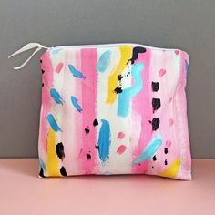 This cotton pouch makes a great make up bag, toiletry bag or pencil case! This multi purpose cotton pouch can be used as a make up bag, pencil case or to organise the bits and bobs collecting at the bottom of your handbag! Printed on both sides, the outer is made from poly cotton with a bright and colourful pattern. The inside has a water resistant lining which makes it perfect to use as a make up or toiletry bag. It has a zip fastening with a sparkly ribbon zip pull. Size: 22 x 16cm/8.6...