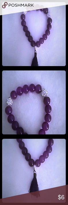TRENDY! Purple beaded tassel bracelet 1/6$ 2/10$ TRENDY and CUTE! NEW! Purple beaded tassel bracelet with 2 faux diamond encrusted beads, fun and flirty this is a great piece for spring and summer! Get 1 for 6$ or 2 for 10$ just pi k your 2 colors and use offer button! check out the other listings in my closet, available in black, clear white, pink, purple and burgundy red! Elastic band for adjustable comfort, great quality! Any questions please feel free to ask! Jewelry