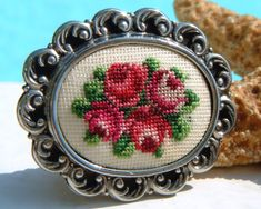 Vintage Needlepoint Embroidered Brooch Pin Petit Point Roses Flowers Embroidery Crewel Needlework Needle Point Silver Tone Frame Miniature Floral Design Wearable Art Jewelry Handwork Crafted This lovely oval shaped vintage brooch or pin . Cross Stitch Rose, Cross Stitch Baby, Cross Stitch Flowers, Ribbon Embroidery, Cross Stitch Embroidery, Cross Stitch Patterns, Minis, Stitch Cartoon, Beaded Banners