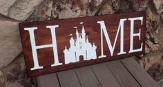 *This handmade sign is perfect for any Disney lover! *Measures approximately 24wide x 9 long  *It is stained and hand painted in white. There is NO VINYL on this sign. *It comes ready to hang with a saw tooth hanger on the back. *All of our signs are made from wood. We make no attempts to cover up knots, grains or other things that natural real wood have. We feel it adds to the beauty and uniqueness of the sign.  *All orders have a 2 week processing time, before shipping. If youd like your…
