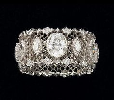 Buccellati Diamond Ring - the integration of the center stone is beautiful. not the biggest fan of large center diamonds, but this is beautiful