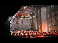 "Tomomi Nishimoto, conductor.  Carl Orff ""Carmina Burana"". (…and i'm so afraid she might fall off the platform )(…and I was right! I don't like the background video)  オーチャード定期演奏会2014.11.14 - YouTube"