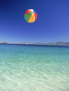 play with a beach ball on the beach
