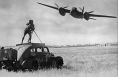 The Australian press get a lens full of Mosquito as de Havilland test pilot Pat Fillingham gives a blistering demonstration at Bankstown in a T3 (A52-1005).