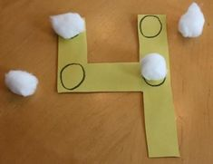 Touch math using cotton balls. It would be interesting to use other materials, too- maybe a different one for each number: buttons, pennies, large sticker stars, felt flowers, large beads, etc.