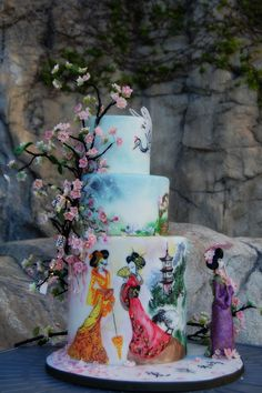 Hand painted and sculpted figures Geisha Themed Wedding Cake by www.CenterRingCakes.com