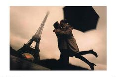 Kissing by the Eiffel Tower