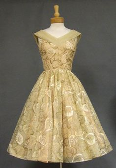 A beautiful 1950's cocktail dress in beige nylon chiffon painted with beige, ivory and gold leaves.