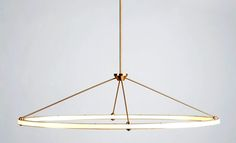 if only i had a bajillion dollars to spend on lighting.  pendant light: halo oval pendant by paul loebach for roll & hill.  pendant lamps: theater of suspension - NYTimes.com