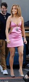 Jennifer Lopez, 46, put on a very busty display and showed offer her toned limbs in a racy pink mini dress on the set of American Idol on Thursday.