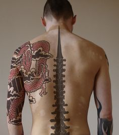 Back Tattoos For Men- i think this is the spine tattoo Jordan wanted
