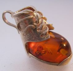 $39.00 Vintage Genuine Amber Baby Shoe Charm Pendant Sterling Silver Fine Jewelry Jewellery FREE SHIPPING by BrightEyesTreasures on Etsy