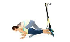 Test out the TRX straps at your gym for this burpee-plank-push-up combo.