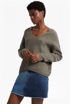 "<ul> <li> Long sleeved v neck wool jumper</li> <li> Fabric: knitted, super soft, slight stretch</li> <li> Slips on</li> <li> V neck and back</li> <li> Drop shoulders</li> <li> Curved hem</li> <li> UK size M centre front measures 39cm</li> </ul> <strong>Our model is 5ft 10.5"" and is wearing a UK size M</strong>"