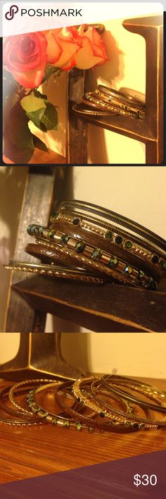 Eclectic Bangle Set 😱Bundle sale extended! Now thru Labor Day bundles of 2 or more items are 30% off🛍 These bangles are an eclectic mix of bohemian and western style. Set of 9 include: 2 golden spiral, 2 antique bronze etched, 2 dark brown hammered, 1 gold with large emerald stained glass beads, 1 gold etched with groups of peridot and emerald rhinestones, and 1 antique bronze ridged. Never worn but so gorgeous I'm not totally sure I want to sell... Jewelry Bracelets