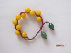 hand chain  用中国结玉线串起来并编织的手链。