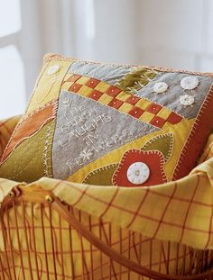 This pillow combines patchwork pieces and hand embroidery with a stitched  quote celebrating the season.