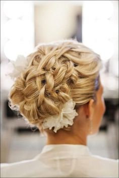 Very pretty top & bottom white flower finishes of the intricate updo.