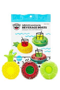 A set of mini inflatable inner tubes by BigMouth™ designed for holding beverages with watermelon, pineapple and lime patterns.